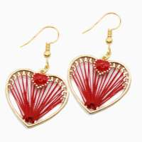 Earrings in red-gold with heart and woven threads