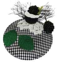 Black white checkered fascinator with blackberry cupcake