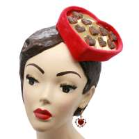 Fascinator in red and gold in the shape of a box of chocolates