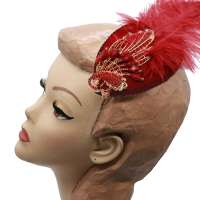 Fascinator with decorative peacock, rhinestones and feather in red