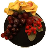 Black fascinator with grapes, berries and yellow roses