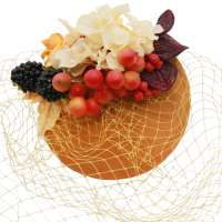 Fascinator in ochre yellow with veil (birdgcage) and flowers